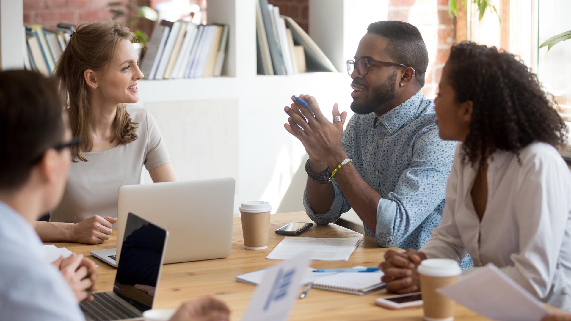 employee speaking sharing ideas at diverse team meeting